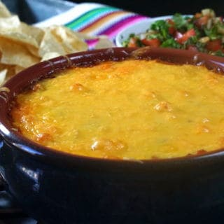 Easy Cheesy Bean Dip is perfect for tailgating and enjoying the big game!